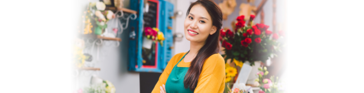 Smiling florist in flower shop, tax resolution in Pleasanton/East Bay, CA and Boston, MA